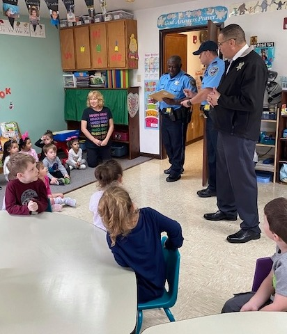 Officers Speak to Children about Parade Safety